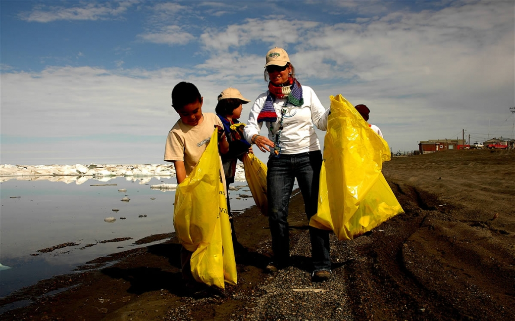 researcher and students cleaning up marine debris