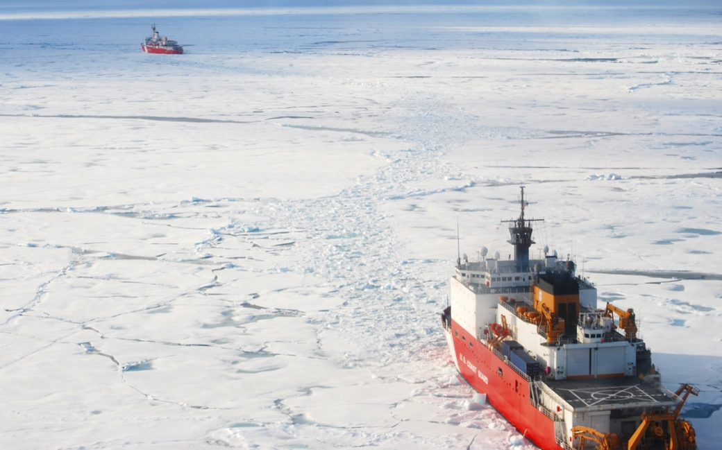 Coast Guard icebreakers traveling in the arctic ice